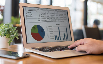 laptop displaying financial charts